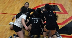 Photo Credit: TIMES PHOTO: MATT SINGLEDECKER - Southridge outside hitter Sofia Basauri and the Skyhawks celebrate their state tournament-clinching win over Sprague on Saturday. The Skyhawks will play in the 6A state tourney for the first time in school history.