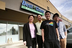 Photo Credit: TIMES PHOTO: JONATHAN HOUSE - Ming Hsu, with his wife Angela, and sons Ryan and Alan stand outside the new Best in Class Education Center in Beaverton, which will help tutor students.