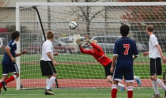 Photo Credit: JOHN WILLIAM HOWARD - Tribe goalkeeper Isaac Hamm dives after the ball midway through the second half. After the game, Hamm was notified of a major accomplishment - Cowapa League keeper of the year.