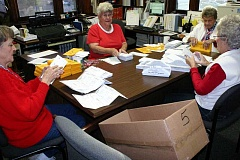 Photo Credit: JASON CHANEY - Ballot opening board members open sealed ballots on Tuesday afternoon in the Crook County Clerk's Office as part of the vote counting process. A total of 9,156 ballots were cast in Crook County. Pictured left to right are Nancy Knoche, Fran Bristow, Ann Hill, and Mardee Carter.