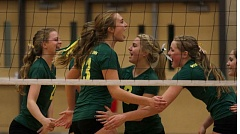 Photo Credit: JON HOUSE - Members of the West Linn volleyball team celebrate a point during last week's second-round playoff match against Clackamas.