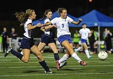Photo Credit: HILLSBORO TRIBUNE PHOTO: AMANDA MILES - Hilhi sophomore midfielder Kennedy Taube fires a shot on goal during Tuesday's Class 5A girls playoff game against Marist. Taube and the Spartans cruised to a 5-1 victory.