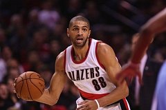 Photo Credit: COURTESY OF DAVID BLAIR - Nicolas Batum looks for an opening in the Denver Nuggets defense in the Blazers; 116-100 victory Sunday night at Moda Center. The Portland forward bruised his right knee and is questionable for Tuesday's home game against Charlotte.
