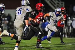 Photo Credit: PHOTO BY JOHN LARIVIERE  - Richie Mock-Seratt avoids tacklers as he rambles for yardage in last Fridays game with McNary. The 6-3, 205-pound Oregon City junior running back has rushed for 365 yards and four touchdowns in the Pioneers last two games.