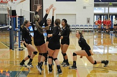Photo Credit: LON AUSTIN/THE PIONEER - Madras players celebrate a big point during Saturday's action. The White Buffalos overcame a first-round loss on Friday to win two matches Saturday and finished fourth, the best showing in the school's history.