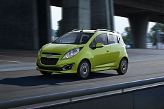 Photo Credit: COURTESY CHEVROLET - The Chevy Spark looks like a 2-door, but the handles for the back door are cleverly hidden in the car's rear pillar. A 5-year, 100,000 mile powertrain warranty is included.
