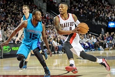 Photo Credit: COURTESY OF MICHAEL WORKMAN - Damian Lillard is on the drive for the Trail Blazers, who rallied to win at home against Charlotte on Tuesday night.