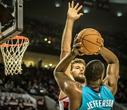 Photo Credit: COURTESY OF MICHAEL WORKMAN - Joel Freeland, Trail Blazers backup center, defends Charlotte star Al Jefferson as Portland wins Tuesday at Moda Center.