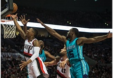 Portland guard Damian Lillard gets inside the Charlotte defense for two of his game-high 29 points Tuesday night at Moda Center.