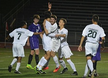 Photo Credit: TIMES PHOTO: MATT SINGLEDECKER - Jesuit's Dylan Ruesch and Henry Rocker celebrate Rueschs goal in the second half of the Crusaders 2-0 second round win over Sunset last week.