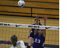 Photo Credit: TIMES PHOTO: MATT SINGLEDECKER - Sunset senior middle blocker Chanel Richardson tries to block a West Albany shot in the second set of the Apollos loss to the Bulldogs on Friday.