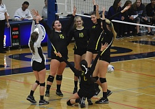 Photo Credit: TIMES PHOTO: MATT SINGLEDECKER - The Jesuit volleyball team celebrates its sweep of McNary in the 6A state quarterfinals on Friday.