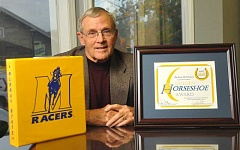 Photo Credit: STAFF PHOTO: VERN UYETAKE - Richard McClintock of Lake Oswego was recently honored with the Golden Horseshoe Award from his alma mater, Murray State University, for designing a new logo.