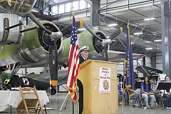 Photo Credit: JEFF WILSON - Ellis Skidmore, 93, Madras, discusses his service in World War II in the U.S. Navy during a veterans event Tuesday at the Erickson Aircraft Collection facility.