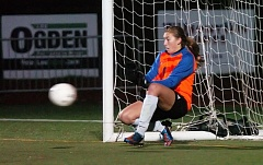 Photo Credit: DAN BROOD - SUPER SAVE -- Tualatin High School junior goalkeeper Emily Leonard makes on of her three penalty-kick saves during the Timberwolves' victory over Westview in Saturday's state playoff quarterfinal match.