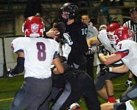 Photo Credit: PAMPLIN MEDIA GROUP: PARKER LEE - SCRAMBLING MAN -- Tigard senior quarterback J.T. Greenough (10) tries to power his way to the end zone in the state playoff opener.
