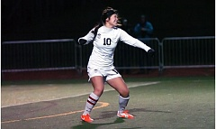 Photo Credit: DAN BROOD - WOLVES WIN -- Tualatin High School senior Natalie Shen starts celebrating following her match-winning goal in the penalty-kick shootout.