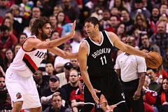 Photo Credit: COURTESY OF DAVID BLAIR - Robin Lopez (left) of the Blazers defends his brother, Brooklyn Nets center Brook Lopez.