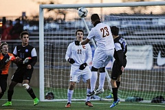 Photo Credit: COURTESY OF JOHN LARIVIERE - Eliezer Gutierrez, Central Catholic defender, heads the ball into the upper-left corner of the net off a corner kick for the Rams' second goal in a 3-0 Class 6A championship victory Saturday against Grant.