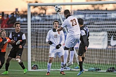 Photo Credit: COURTESY OF JOHN LARIVIERE - Eliezer Gutierrez, Central Catholic defender, heads the ball into the upper-left corner of the net off a corner kick for the Rams second goal in a 3-0 Class 6A championship victory against Grant.