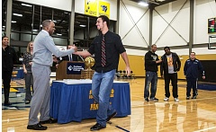 Coach Tony Broadous (left) congratulates former Portland Community College basketball player Anthony Hines during Monday's ring ceremony for the 2013-14 Panthers basketball team that won the NWAACC championship.