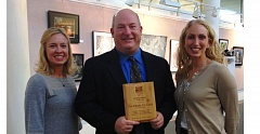 Photo Credit: COURTESY OF GRESHAM - Gresham Building Official Eric Schmidt holds his award after a ceremony in council chambers. He is flanked by past Oregon Building Official Association president Melanie Adams and current president Cheryl Dell.