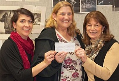 Photo Credit: SUBMITTED PHOTO - Jenni Amiel incoming leader of the Charbonneau Arts Festival and Leslie Leeper the outgoing leader present the check to Canby High art teacher Jennifer Dorsey.