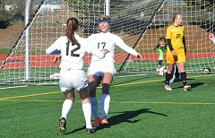 Photo Credit: TIMES PHOTO: MATT SINGLEDECKER - Valley Catholic seniors Ella Turkot and Jessi Beyer celebrate Turkots corner kick goal in the first half of the Valiants 3-2 4A state championship win over Cascade on Saturday at Liberty High.
