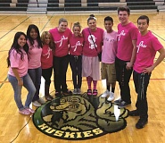 Photo Credit: KRIS KNOX - Students in North Marion High School's leadership pose at an assembly last month kicking off Pink Out Week, during which the school raises money for local breast cancer survivors. Since 2009, the school has raised $7,400, including $1,000 that was raised just this year.