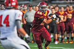 Photo Credit: COURTESY OF JOHN LARIVIERE - Senior Cameron Scarlett, whose return from injury at running back has lifted Central Catholics offense to new heights this year, says the Rams are hungrier to win the state title than they were even a year ago.