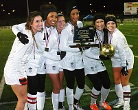 Photo Credit: DAN BROOD - The Tualatin High School girls soccer team's six seniors, (from left) Joslyn Gastiaburu, Ariana Pumpelly, Adina Goodwin, Aryana Harvey, Natalie Shen and Kyla Hackelman gather with the state championship trophy following the Wolves' 2-0 win over North Medford.