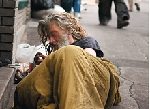 Photo Credit: TRIBUNE: FILE PHOTO - A man wakes up from sleeping on the sidewalk along West Burnside Street outside the Portland Rescue Mission. The number of homeless outnumber the number of beds available.