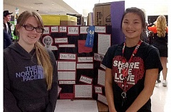 Photo Credit: MOLALLA HIGH SCHOOL - Students Clancy Paul and Nell Danforth with their display at last week's MRSD Showcase Night event.