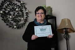 Photo Credit: JASON CHANEY - Becky Groves displays an award she received from Basic Rights Oregon.
