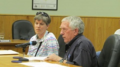 Photo Credit: COURTNEY VAUGHN - Anne Scholz and Keith Forsythe address the Scappoose City Council Monday evening, Nov. 17, regarding the Eisenschmidt Pool in St. Helens. The Greater St. Helens Parks and Recreation District, which manages the pool, expressed interest this year in annexing Scappoose into the district, but backed out Tuesday after hearing from the council.