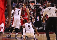 Photo Credit: COURTESY OF DAVID BLAIR - Wesley Matthews of the Blazers shoves Chicago's Mike Dunleavy after the Bulls forward fouled Portland guard Damian Lillard on a 3-point shot Friday night at Moda Center.