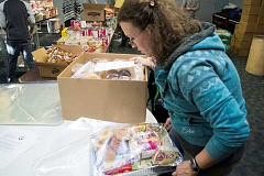Union Gospel Mission volunteers packed 500 Thanksgiving meals for the needy on Saturday. The baskets will be delivered by a network of churches and other organizations.