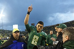 Photo Credit: TRIBUNE PHOTO: JAIME VALDEZ - Oreon Ducks quarterback Marcus Mariota leaves Autzen Stadium after Saturday's Colorado game.