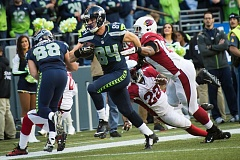 Tight end Cooper Helfet heads to the end zone with a clinching touchdown late in the third quarter Sunday, as the Seattle Seahawks defeat the Arizona Cardinals 19-3 at CenturyLink Field.