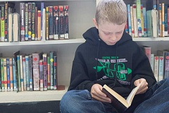 Photo Credit: KEVIN SPERL - Connor Vaughan's love for reading earned him a $529 Oregon College Savings Plan scholarship.