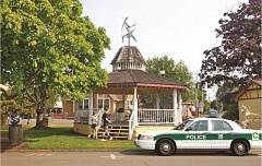 Photo Credit: RIC STEPHENS/UNIVERSITY OF OREGON - This rendering, taken from the slideshow at the Nov. 17 presentation, shows possible improvements to Mount Angel, including a wind energy vane on top of the gazebo, a mural program, as shown on the outbuilding to the right, and a Bavarian-style police car that would use ethanol fuel.