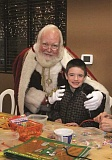 Photo Credit: FILE PHOTO - Santa Claus will visit with children at the annual Hazelnut Fest, which also features a craft room to keep the young ones busy.