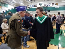 Photo Credit: BARBARA SHERMAN - A Tigard HIgh School choir member shakes hands with Summerfield resident and World War II veteran Marion Hill following the Veteran's Day assembly.