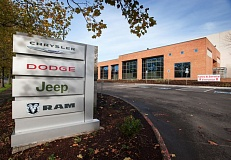 Photo Credit: TRIBUNE PHOTO JOHN M. VINCENT - The former Hollywood Video warehouse has become Findlay Automotive Group's new Chrysler Jeep Dodge Ram dealership in Wilsonville. The Las Vegas-based dealership group has 28 locations in 5 western states.