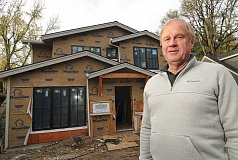 Photo Credit: STAFF PHOTOS: VERN UYETAKE - Longtime homebuilder and Lake Oswego resident Larry Todd stands in front of a spec home he is building. Todd says he loves what he does and cant wait to get up every morning.