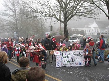 Photo Credit: SUBMITTED PHOTO - The West Linn holiday parade is a parade with a purpose. Participants and audience members are encouraged to bring nonperisable food and new, unwrapped toys for those in need.