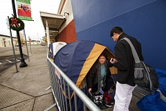 Photo Credit: OUTLOOK PHOTO: TROY WAYRYNEN - Shoppers, like Dee Dee Hernandez, camp outside a Best Buy store at Gresham Station Wednesday Nov. 26, to be some of the first to take advantage of holiday shopping discounts Thanksgiving day.