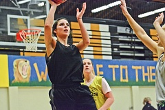 Photo Credit: JOHN WILLIAM HOWARD - Maggie Cochran looks for a basket along the baseline during practice on Tuesday evening. Head coach Billy McKinney said he'll be counting on Cochran, along with senior Rianne Tupper and Emily Nollette, to handle large portions of the offense this season.