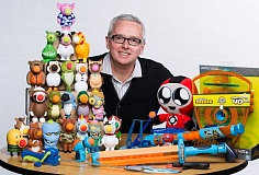 Photo Credit: SUBMITTED PHOTO - Joe Rooper is surrounded by many of his creations at Hog Wild Toys. The company specializes in things that are totally silly but totally delightful.
