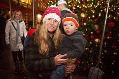 Photo Credit: TIMES PHOTO: ADAM WICKHAM - Kimberly Hunt and her son Colton, 2,  at the Bridgeport Village Tree Lighting ceremony and Santa reveal.